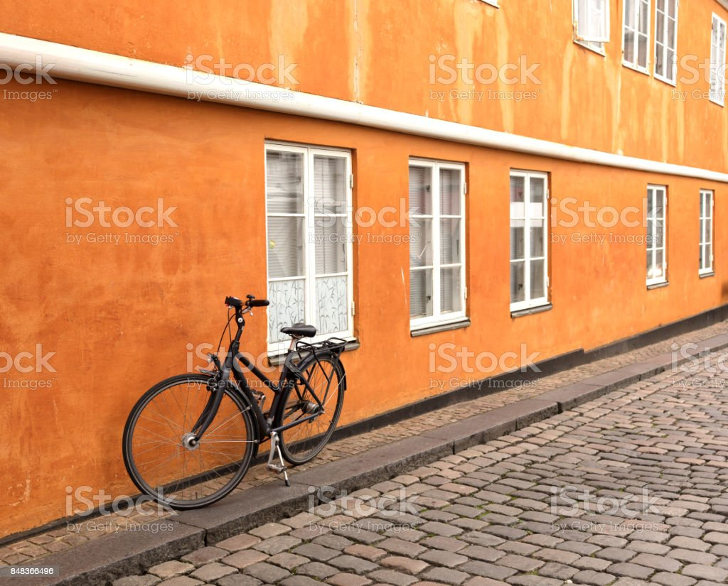 black bicycle leaning stock photo