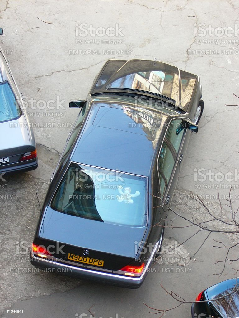 Black big parking Mercedes S500 car between another cars stock photo