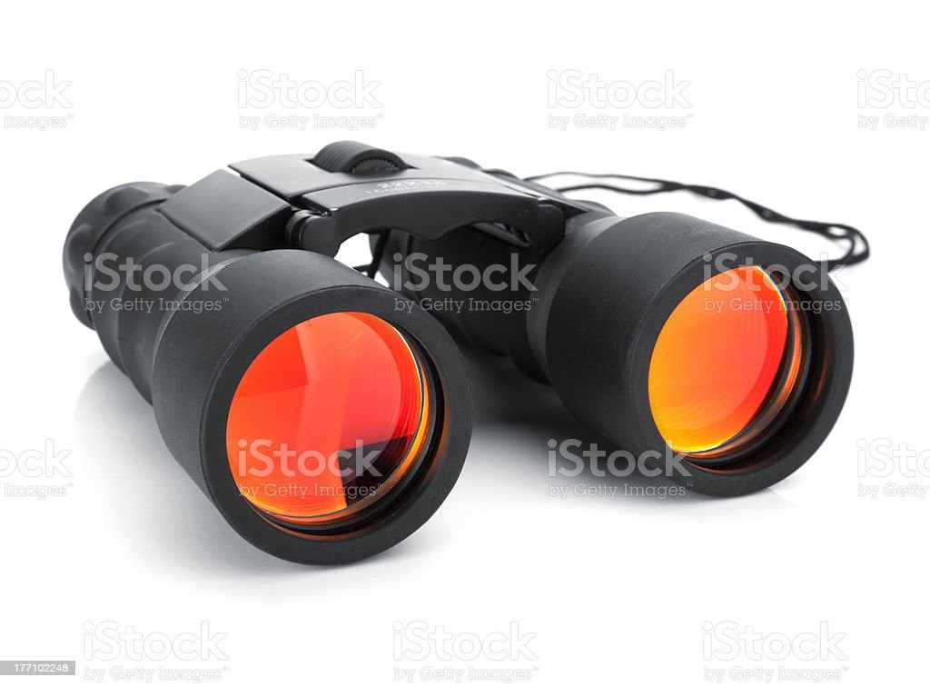 Black binoculars with orange and yellow lenses  stock photo