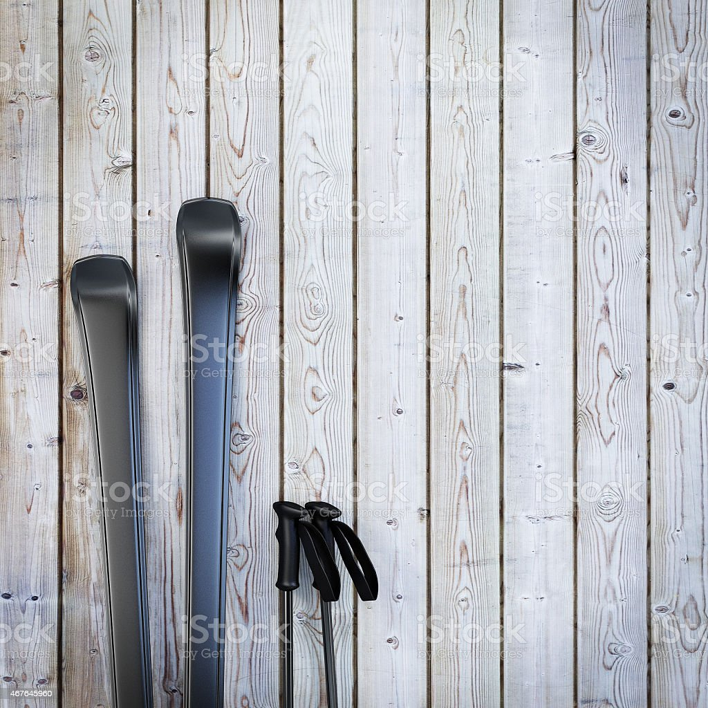black blank skis on wooden planks wall stock photo