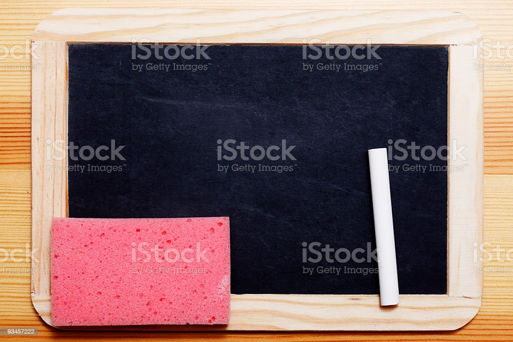Black Board with chalk and sponge stock photo