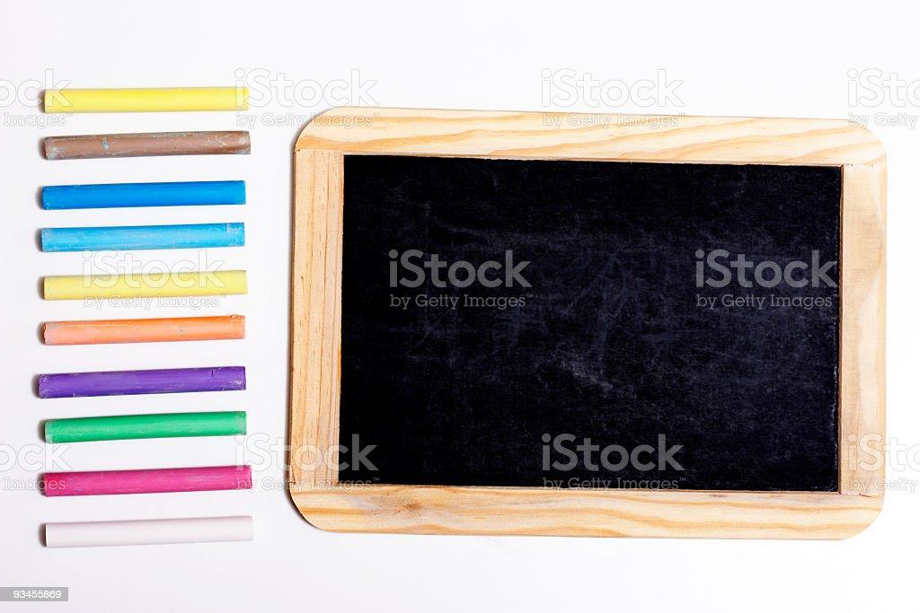 Black Board with multi colored chalk stock photo
