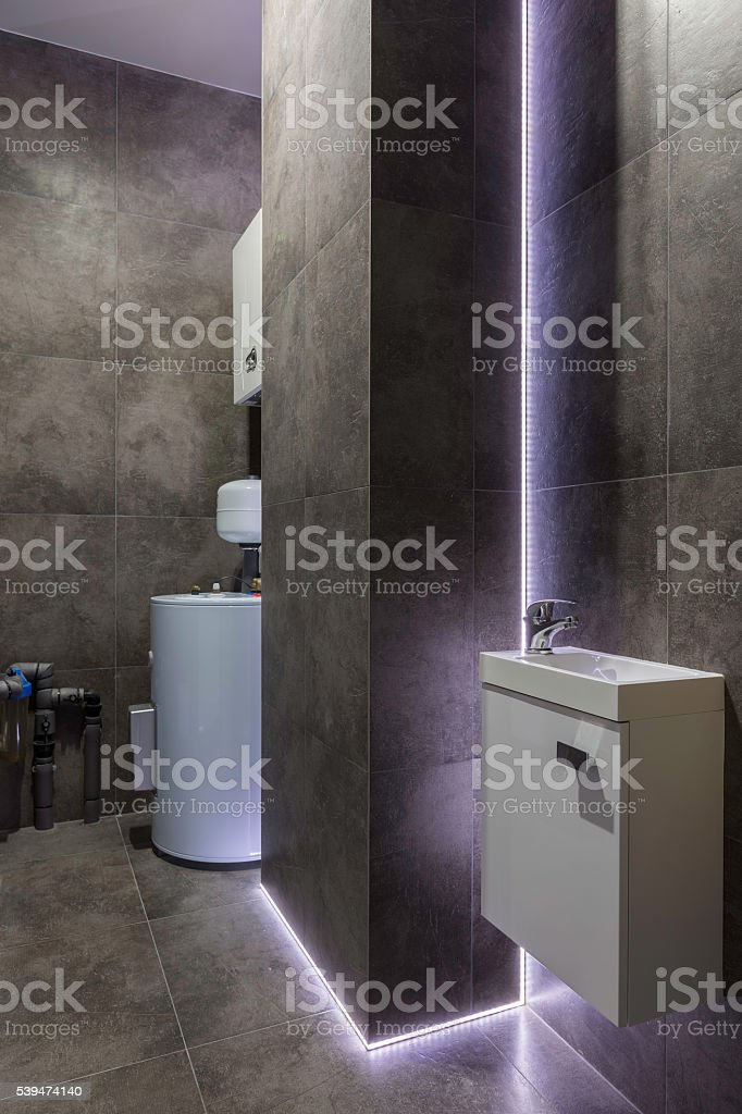 Black boiler room  with decorative purple led light stock photo