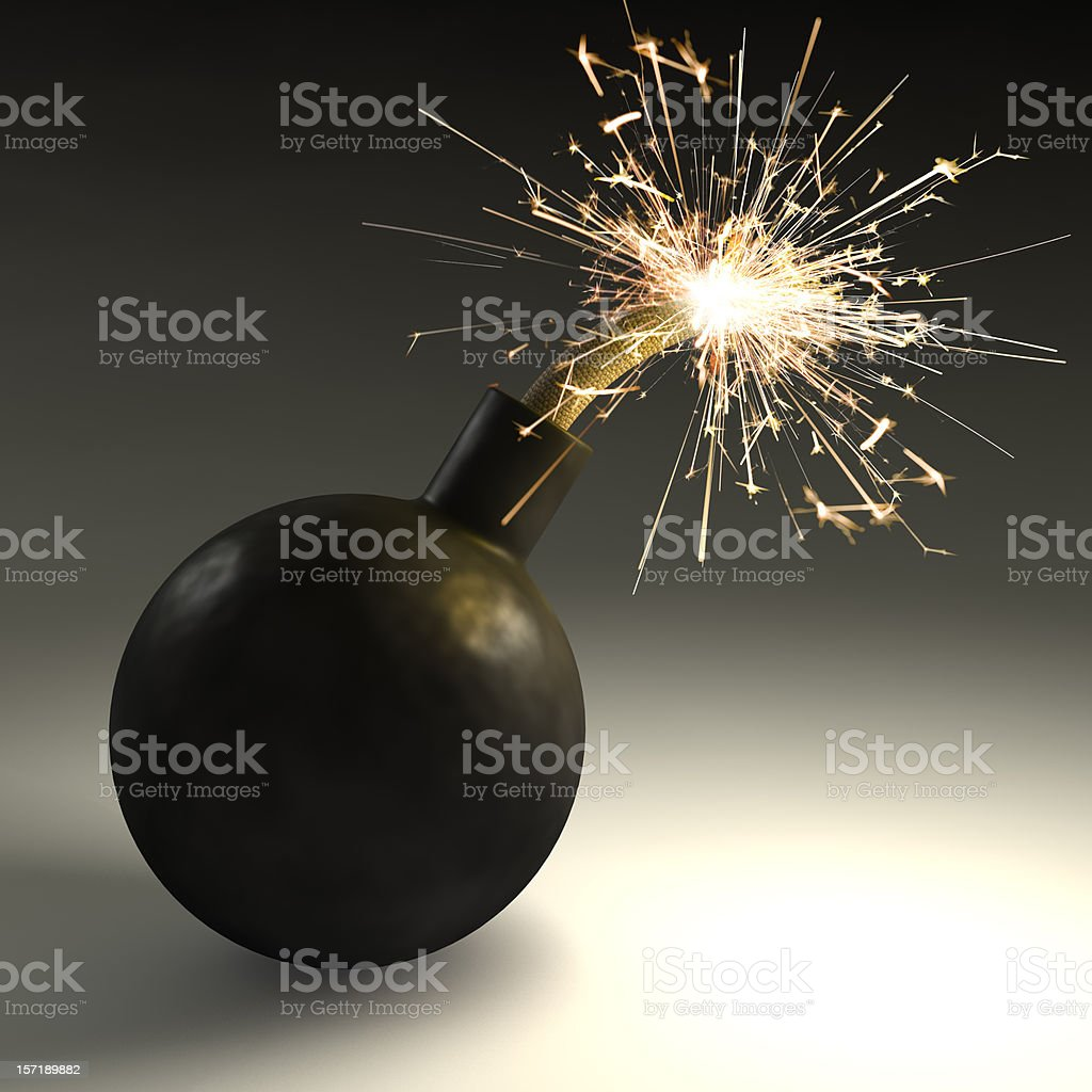 A black bomb with sparks coming out of the top stock photo