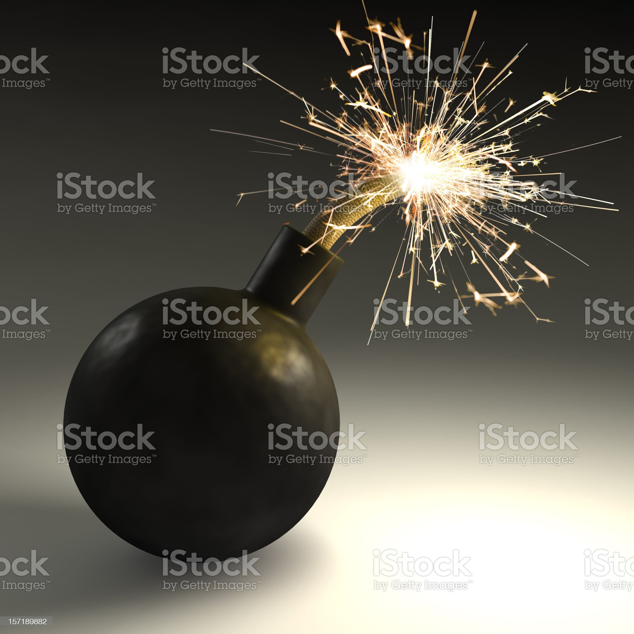 A black bomb with sparks coming out of the top royalty-free stock photo