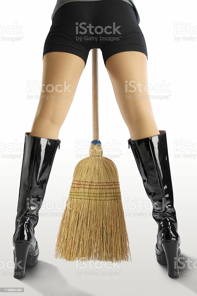 Black boots and besom stock photo