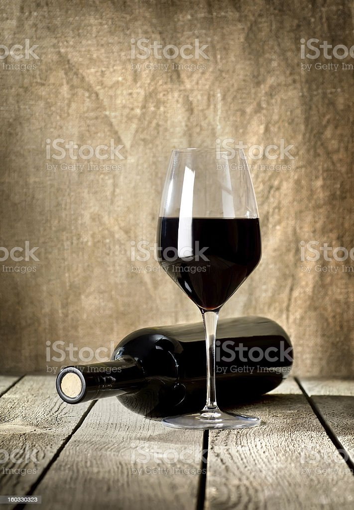 Black bottle of wine and wneglass royalty-free stock photo