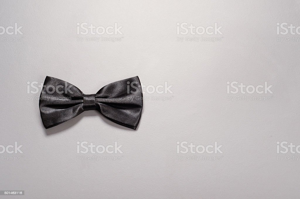 Black bow tie on gray background stock photo