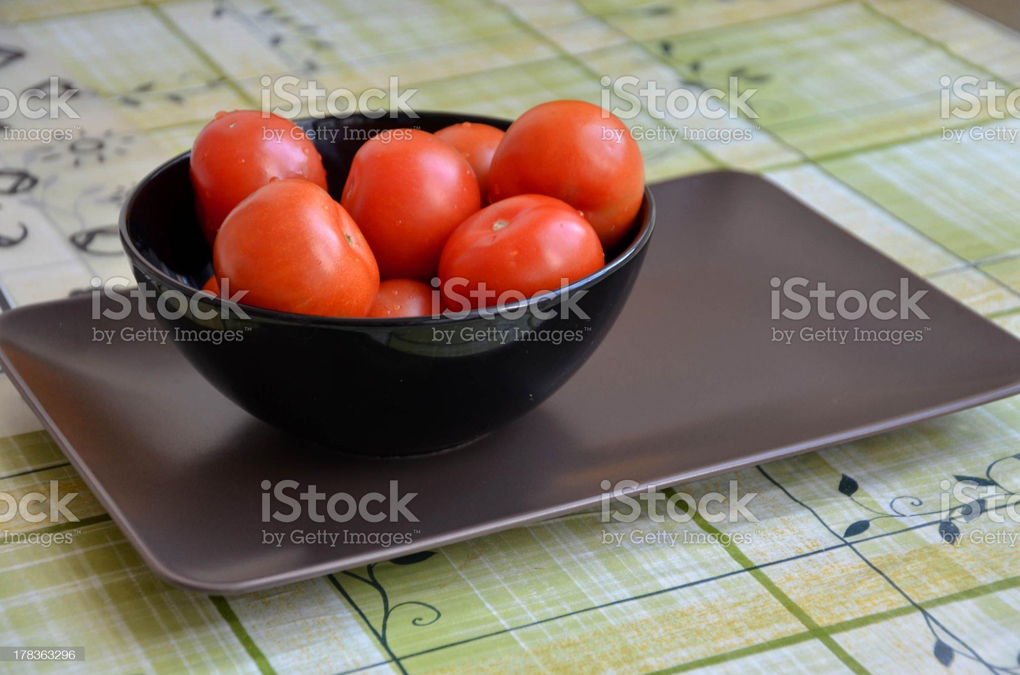 Black bowl full of tomatoes royalty-free stock photo