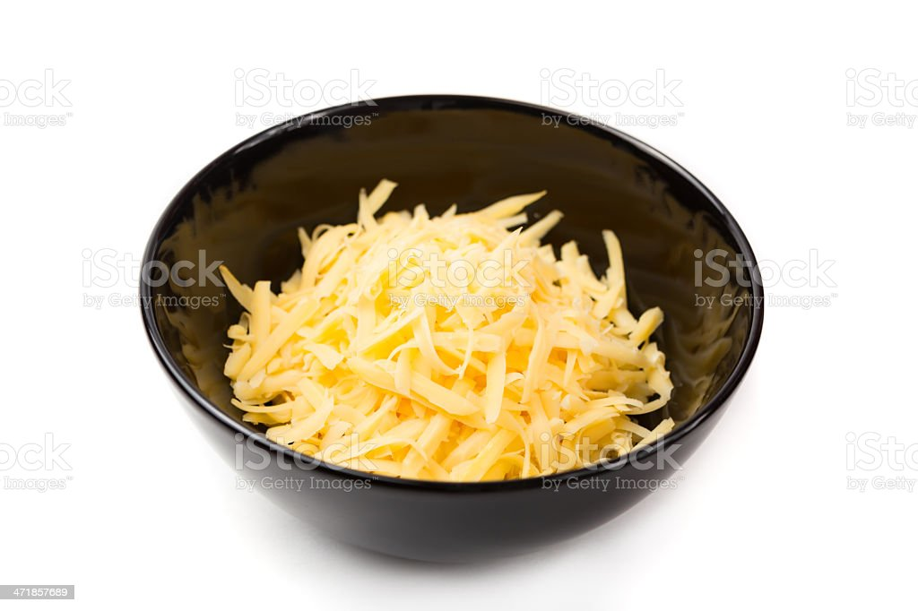 A black bowl of grated cheddar cheese stock photo