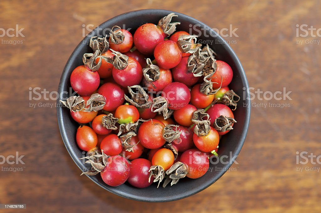 Black Bowl of Wild Rose Hips from Above royalty-free stock photo