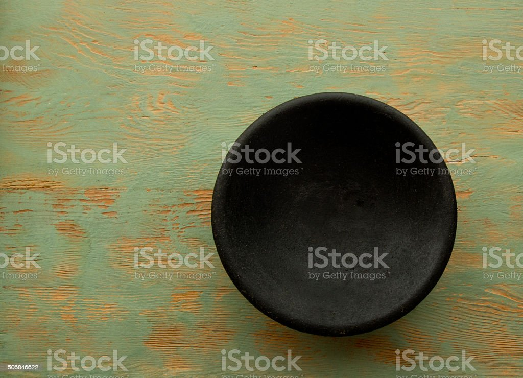 Black Bowl, Old Green Wood Table, Copy Space, Full Frame stock photo