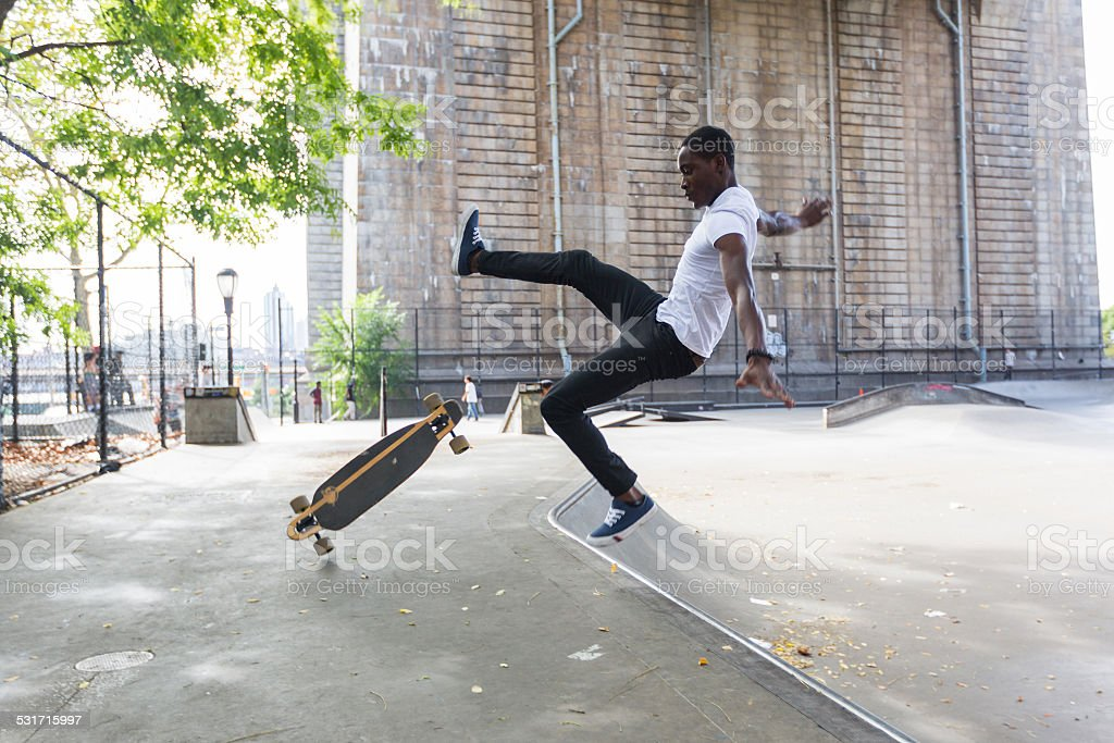 Black Boy Skating at Park and Falling Down stock photo