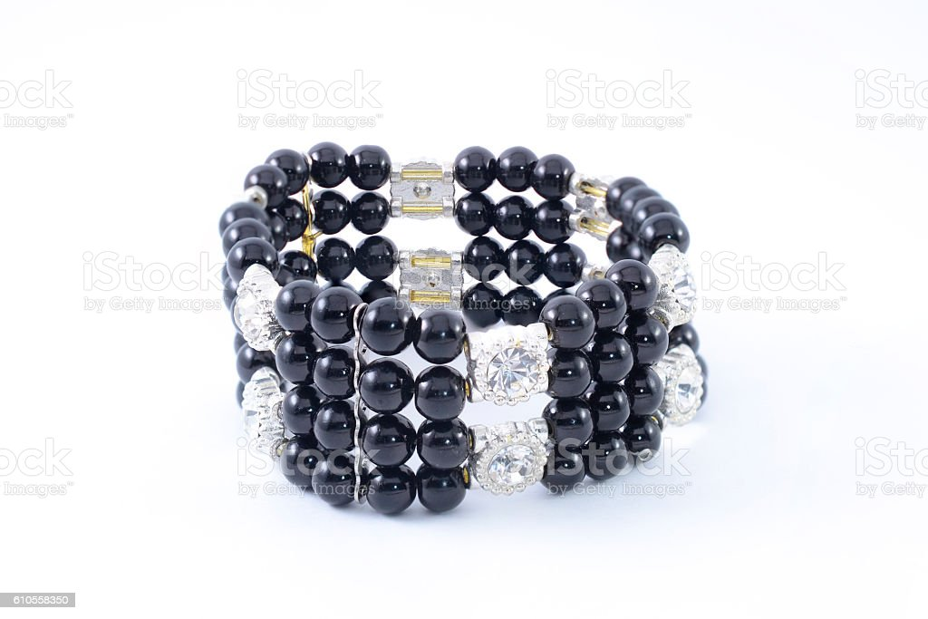 Black bracelet with beads on a white background stock photo