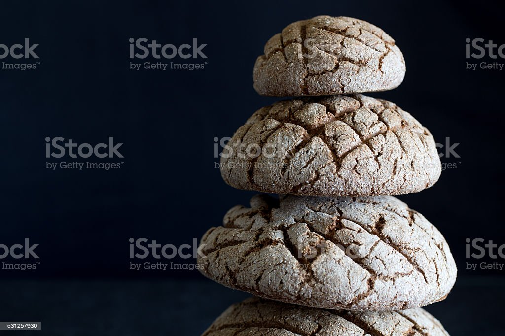 black bread on black table close-up. Traditional black rye-bread stock photo