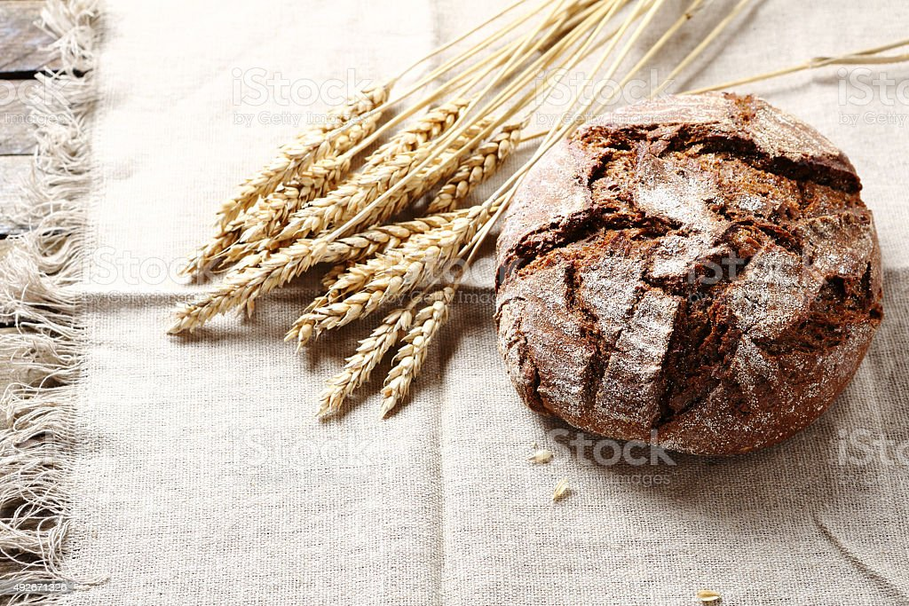 Black bread  on rustic background stock photo