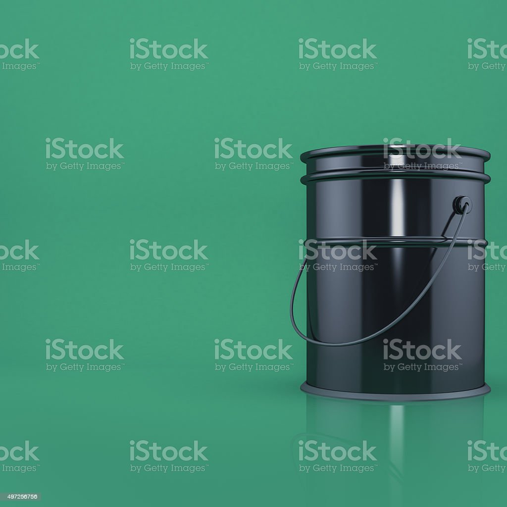 Black bucket on a green background stock photo