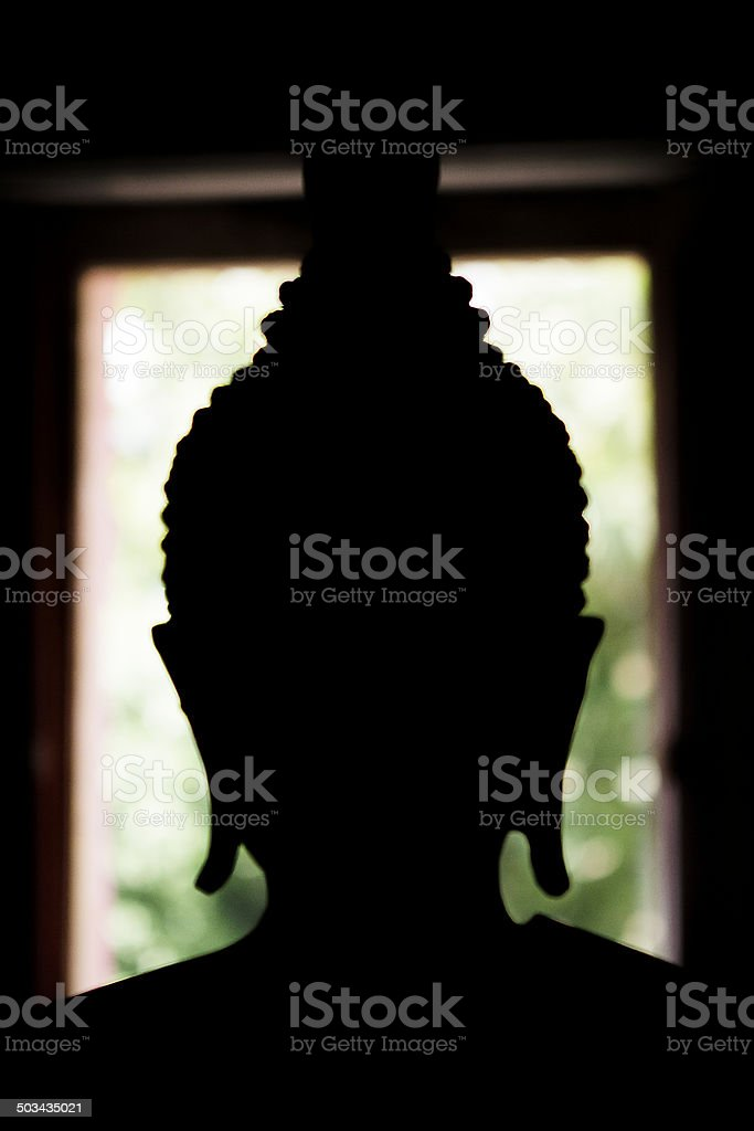 Black buddha silhouette stock photo