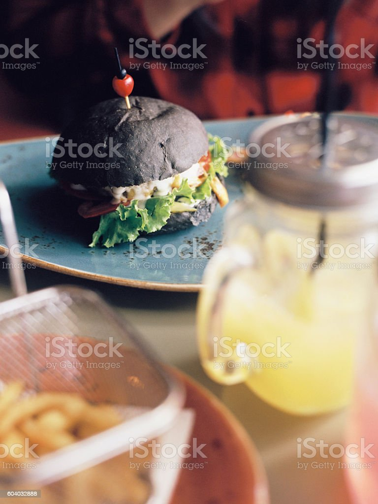 Black burger and rustic drinks royalty-free stock photo