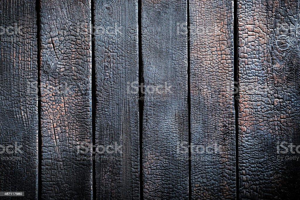 Black burnt wooden table stock photo