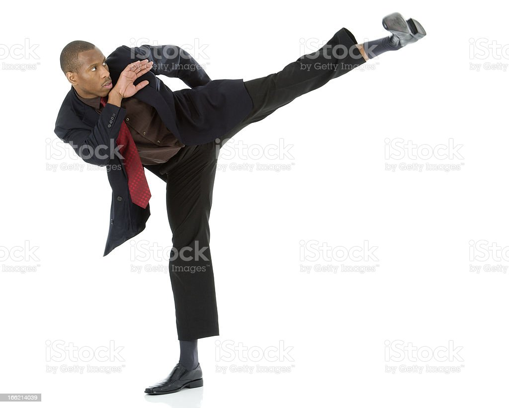 Black busines man attacking the competition (conceptual) stock photo