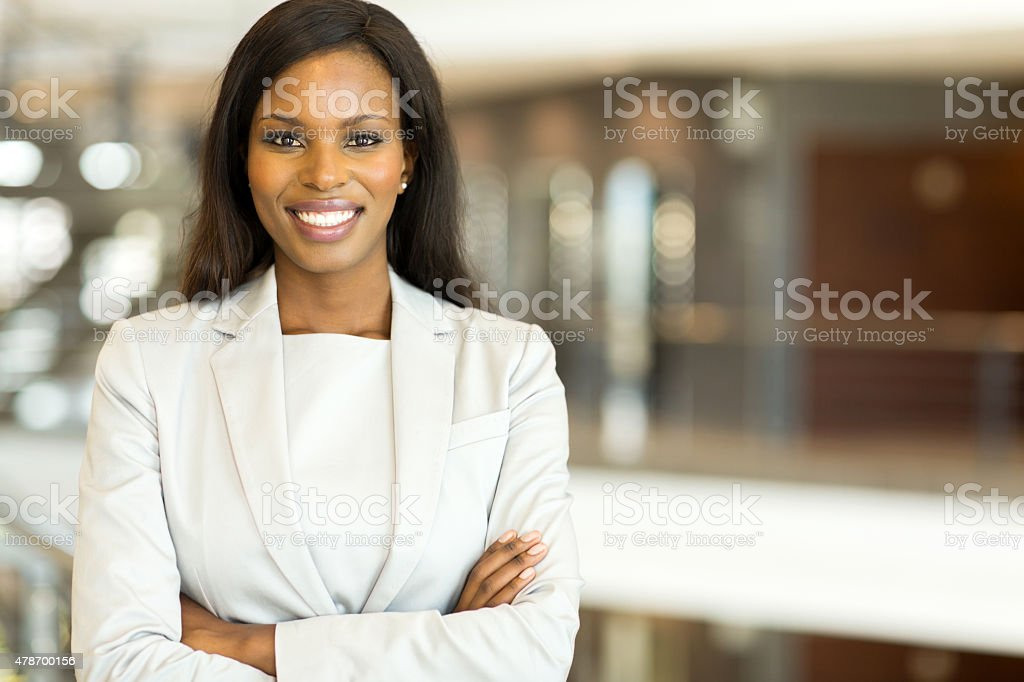 black business executive with arms crossed stock photo