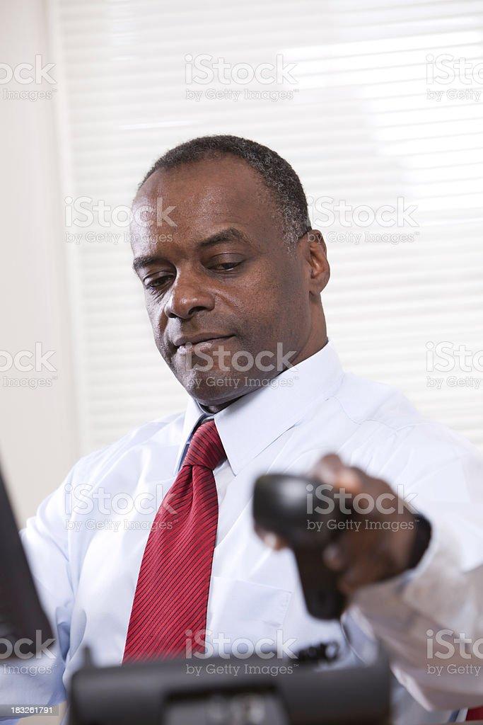 Black Business Man using phone stock photo