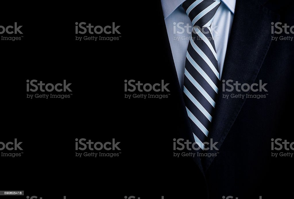 Black business suit with a tie and copyspace background stock photo
