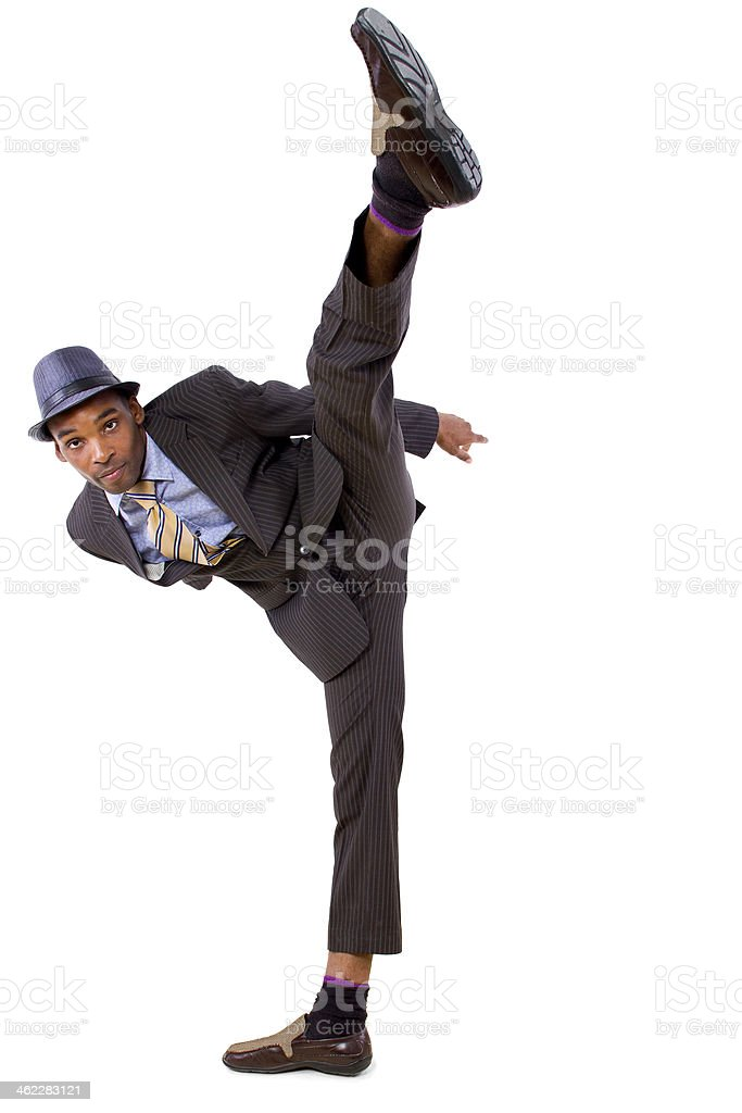 Black Businessman Doing a Kick on a White Background stock photo