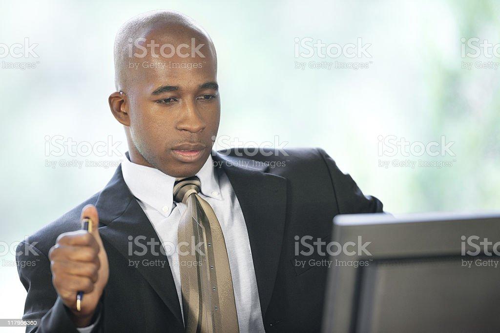 Black Businessman Looking At Computer royalty-free stock photo