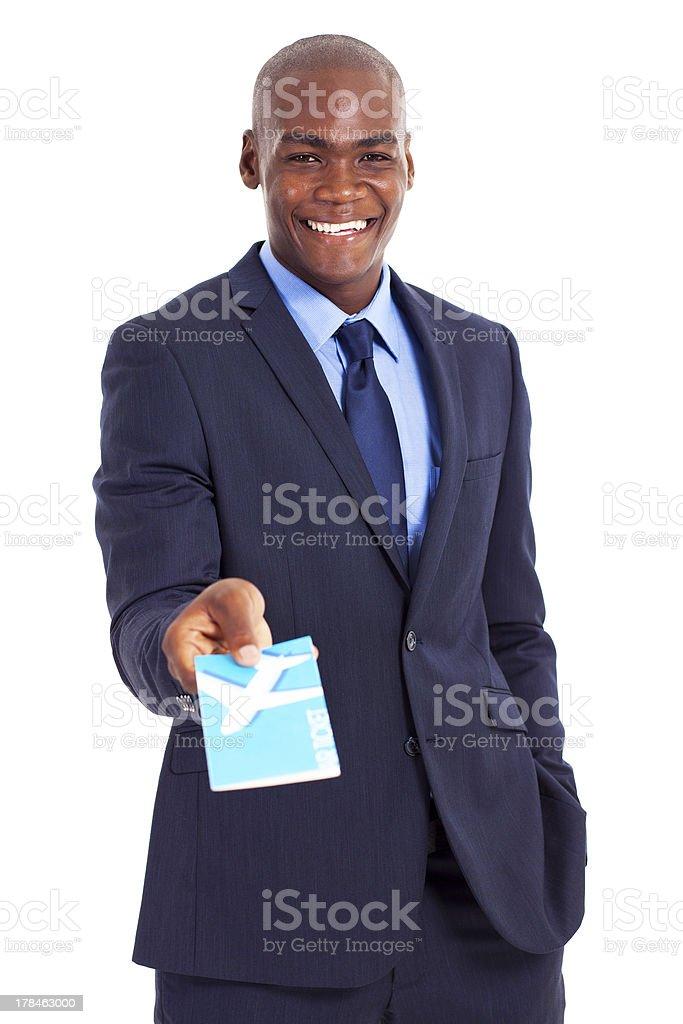 black businessman presenting air ticket royalty-free stock photo