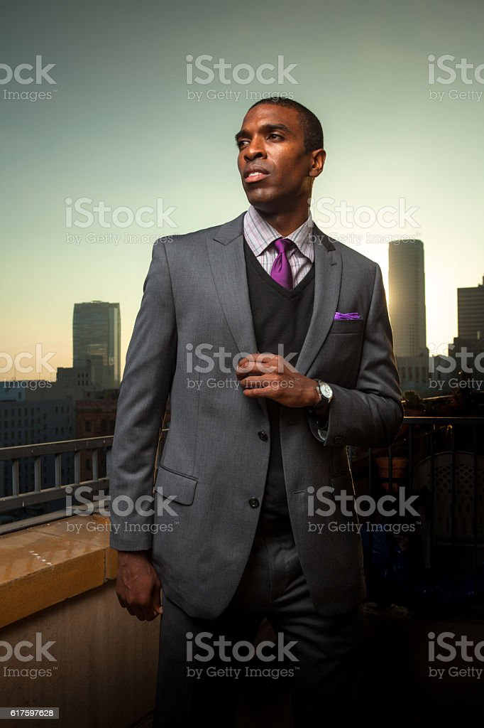Black Businessman with Urban Skyline in Background stock photo