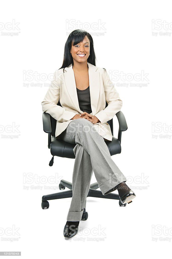 Black businesswoman sitting in office chair stock photo