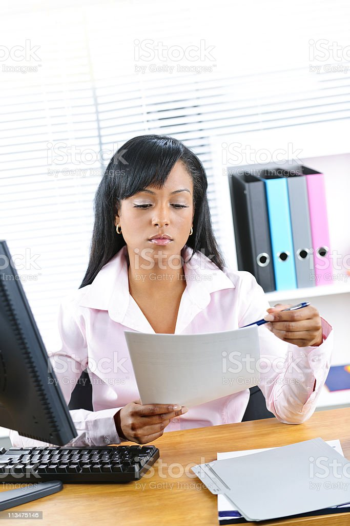 Black businesswoman working at desk stock photo