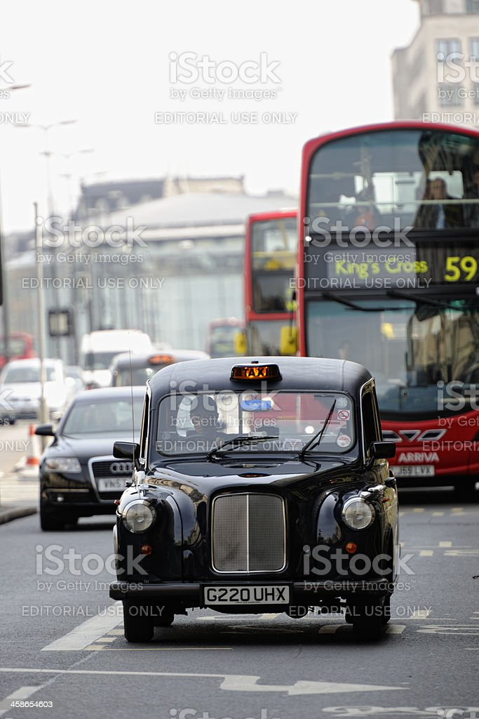 Black Cab on Waterloo Bridge London royalty-free stock photo