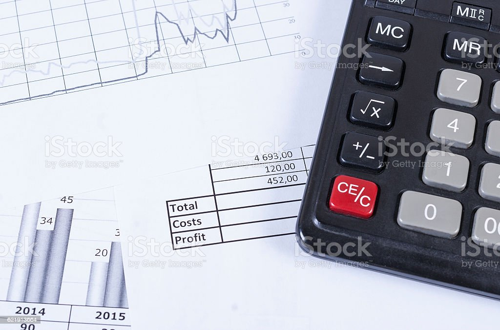 Black calculator on the graphic and the financial statements. stock photo