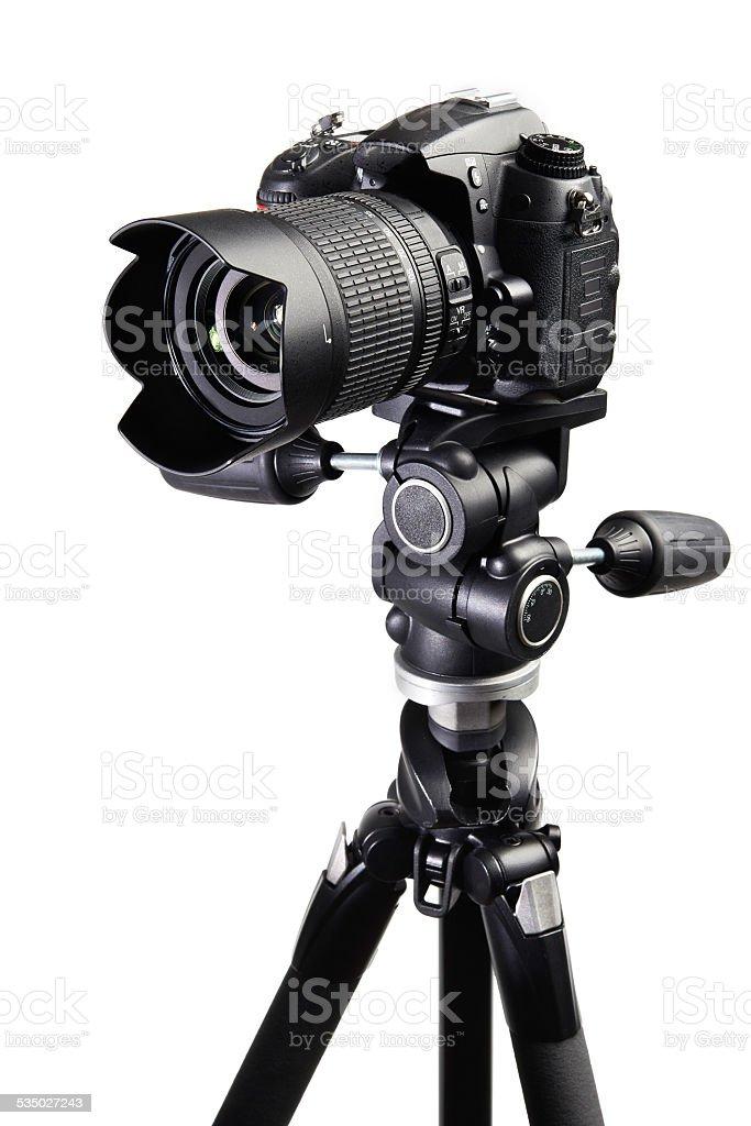 DSLR black camera on tripod stock photo