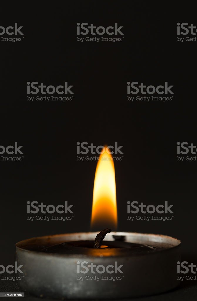 Black candle stock photo