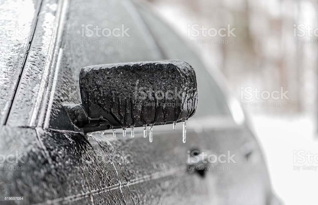 Black car covered in freezing rain, ice covered vehicle. stock photo