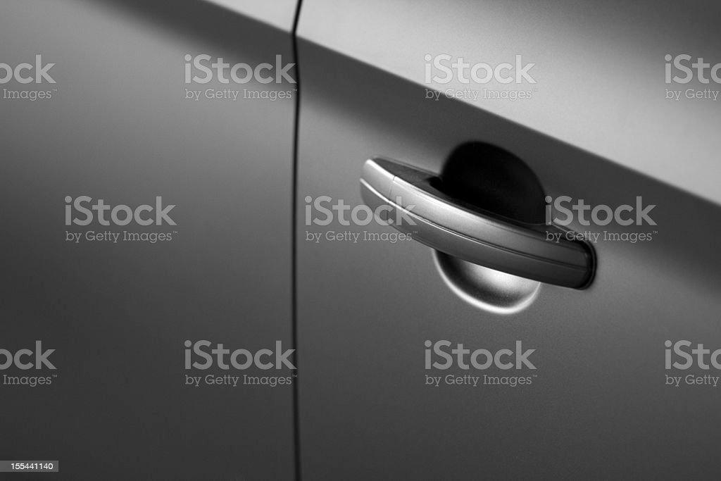 Black car doorhandle close up stock photo