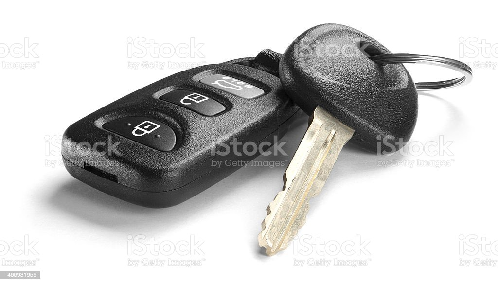 Black car key and remote on white background stock photo