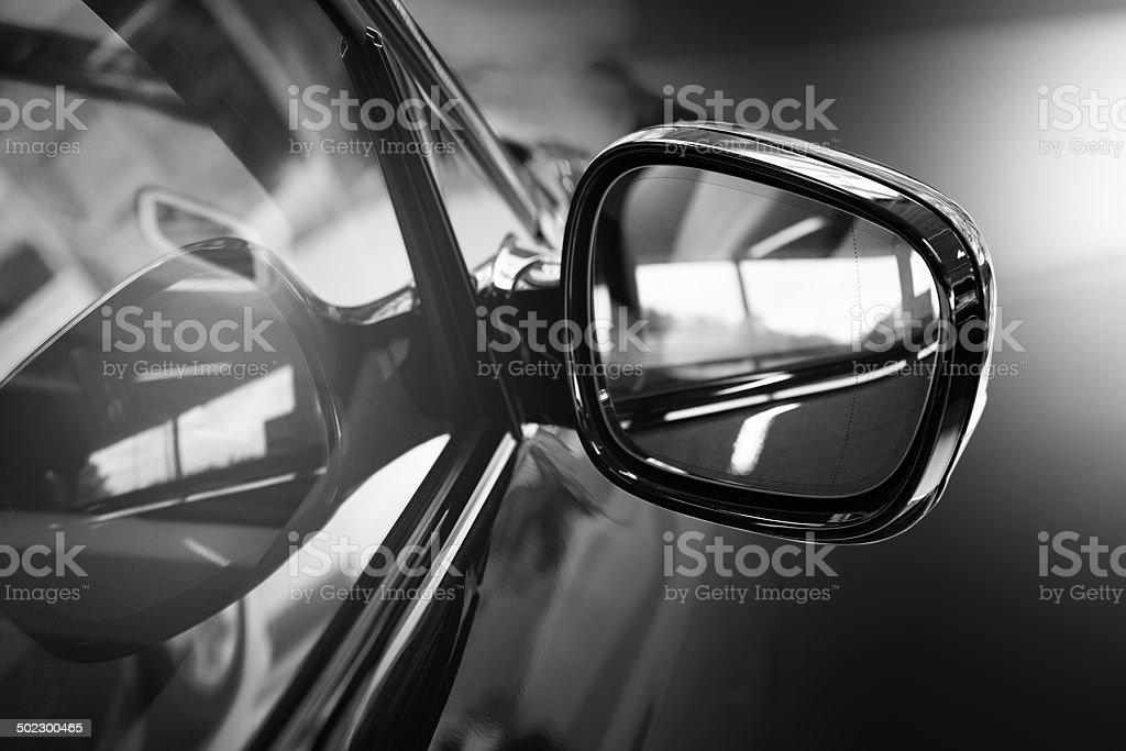 Black Car side mirror close up, backlite stock photo