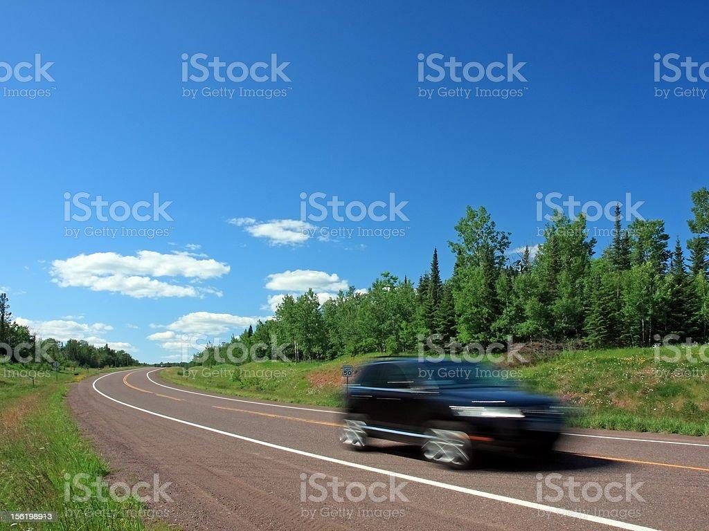 Black car speeding royalty-free stock photo
