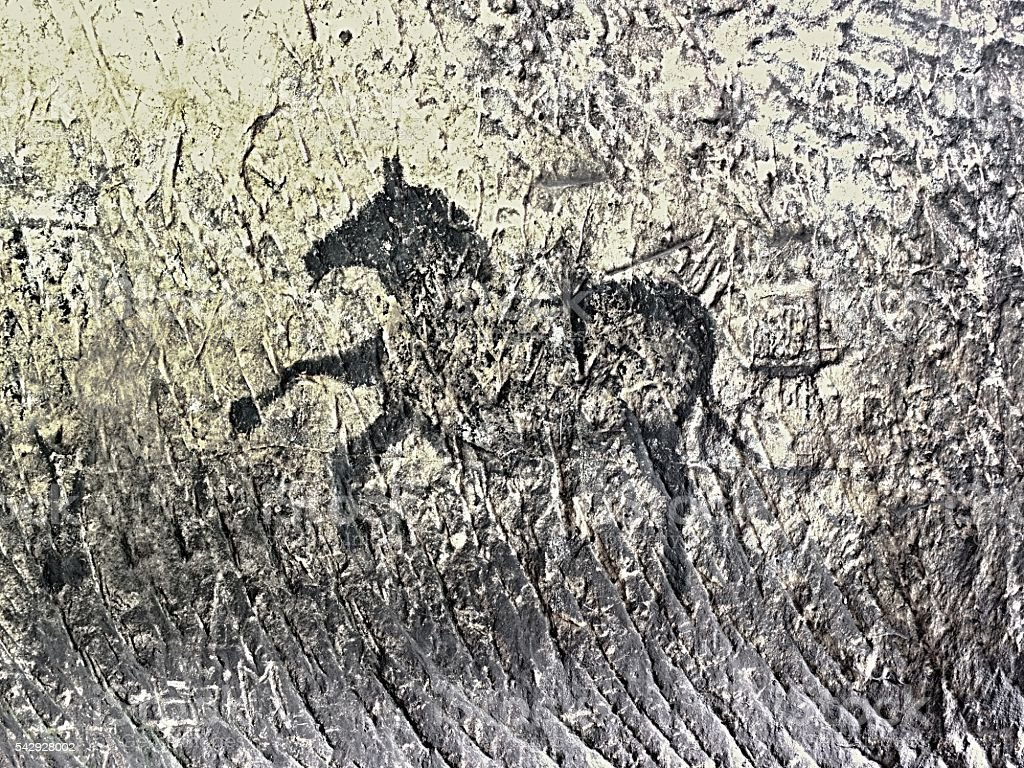 Black carbon paint of horses on sandstone wall stock photo