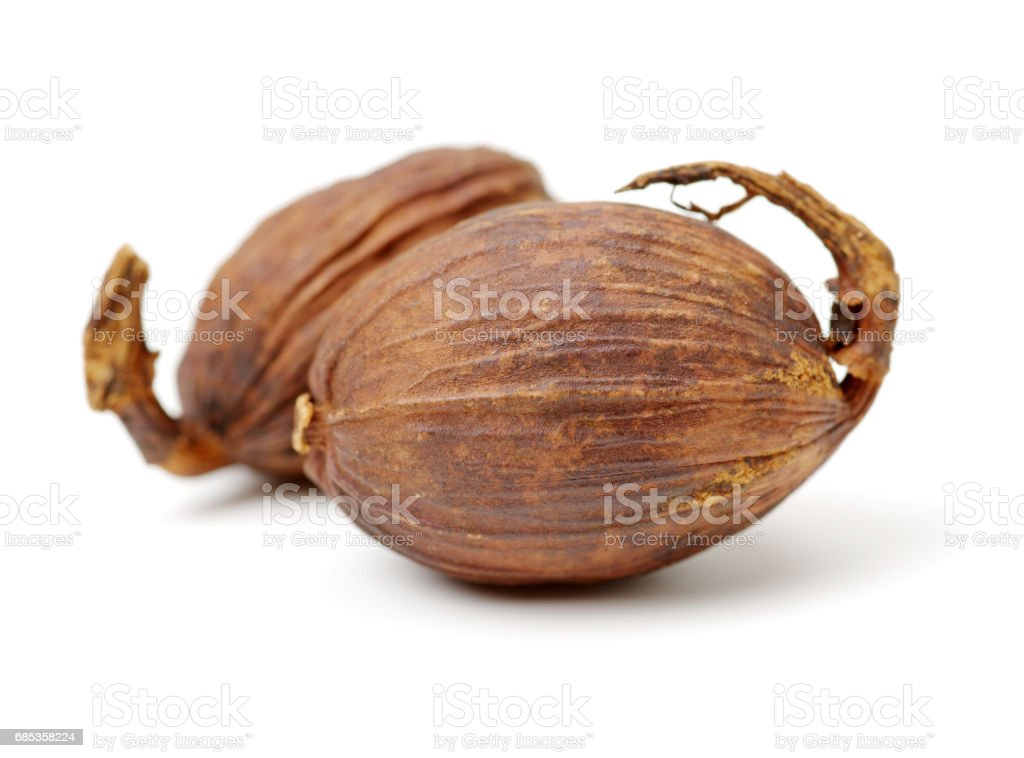 Black cardamom on a white background stock photo