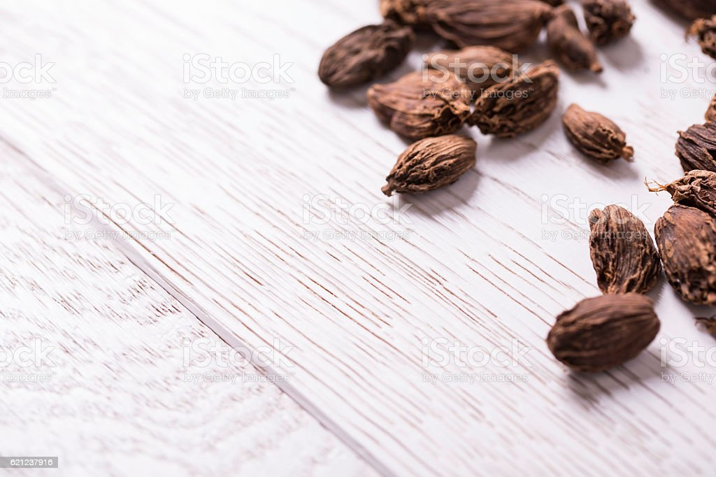 black cardamom on wooden table stock photo