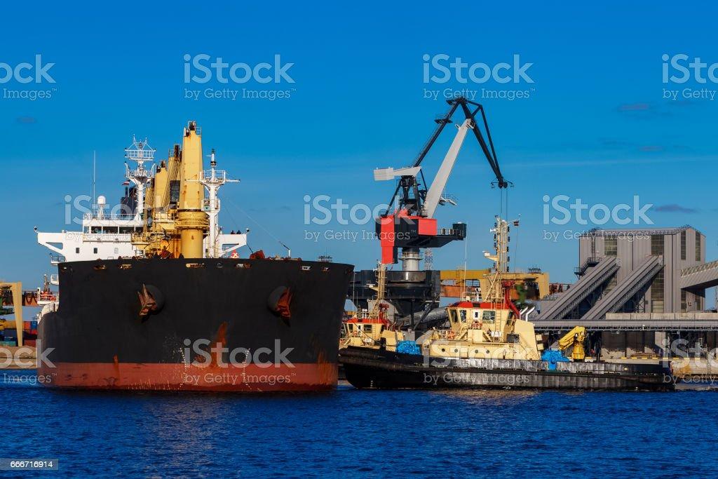 Black cargo ship mooring stock photo