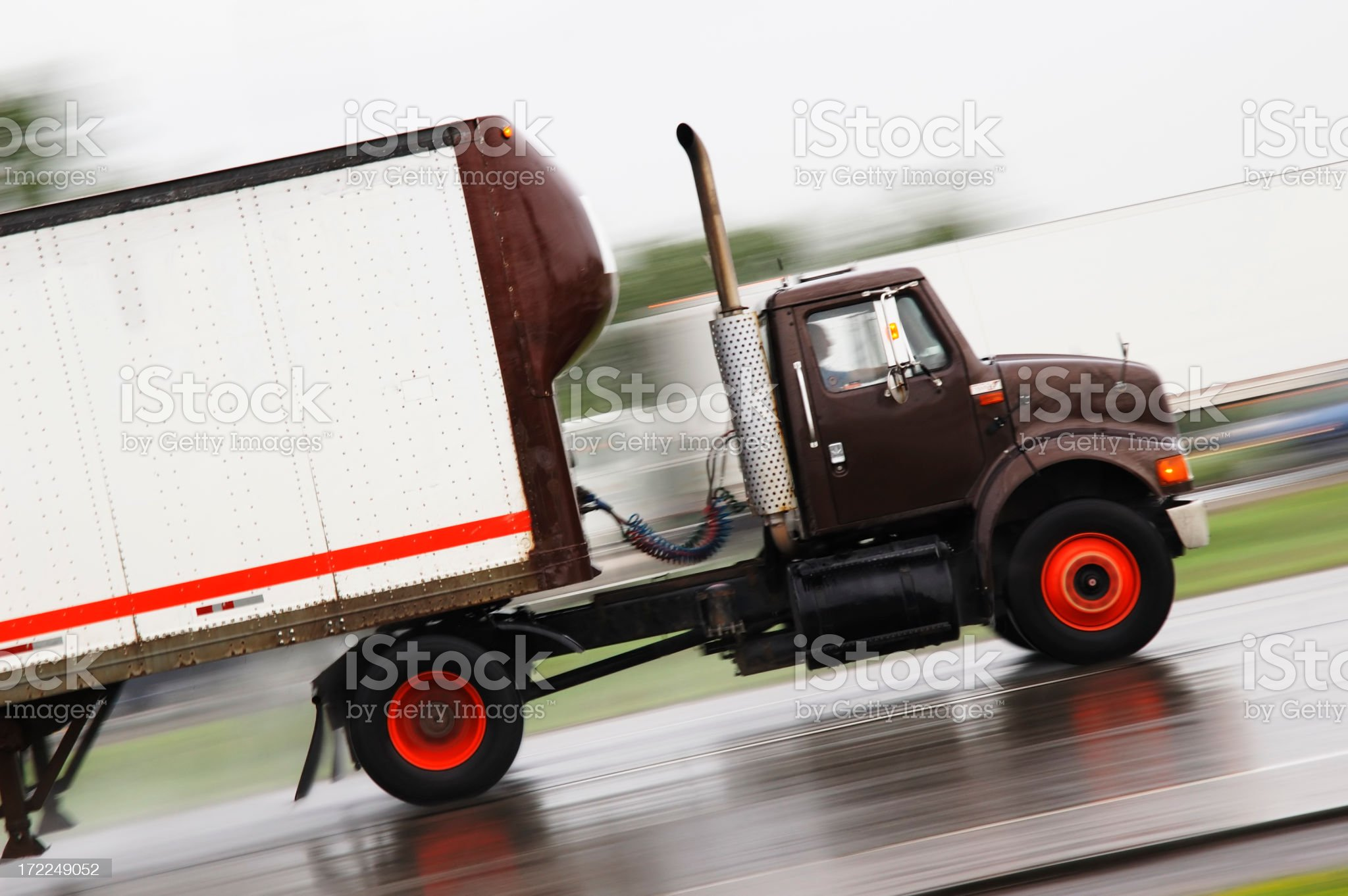 Black cargo truck speeding in the road royalty-free stock photo