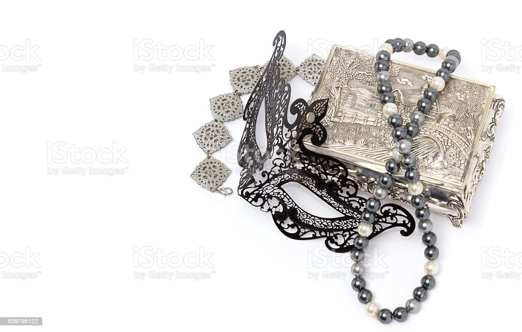 Black carnivale mask with silver bracelet and box stock photo