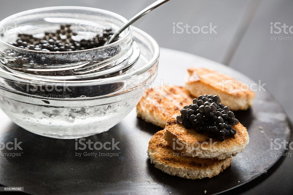 Black caviar and tarts stock photo